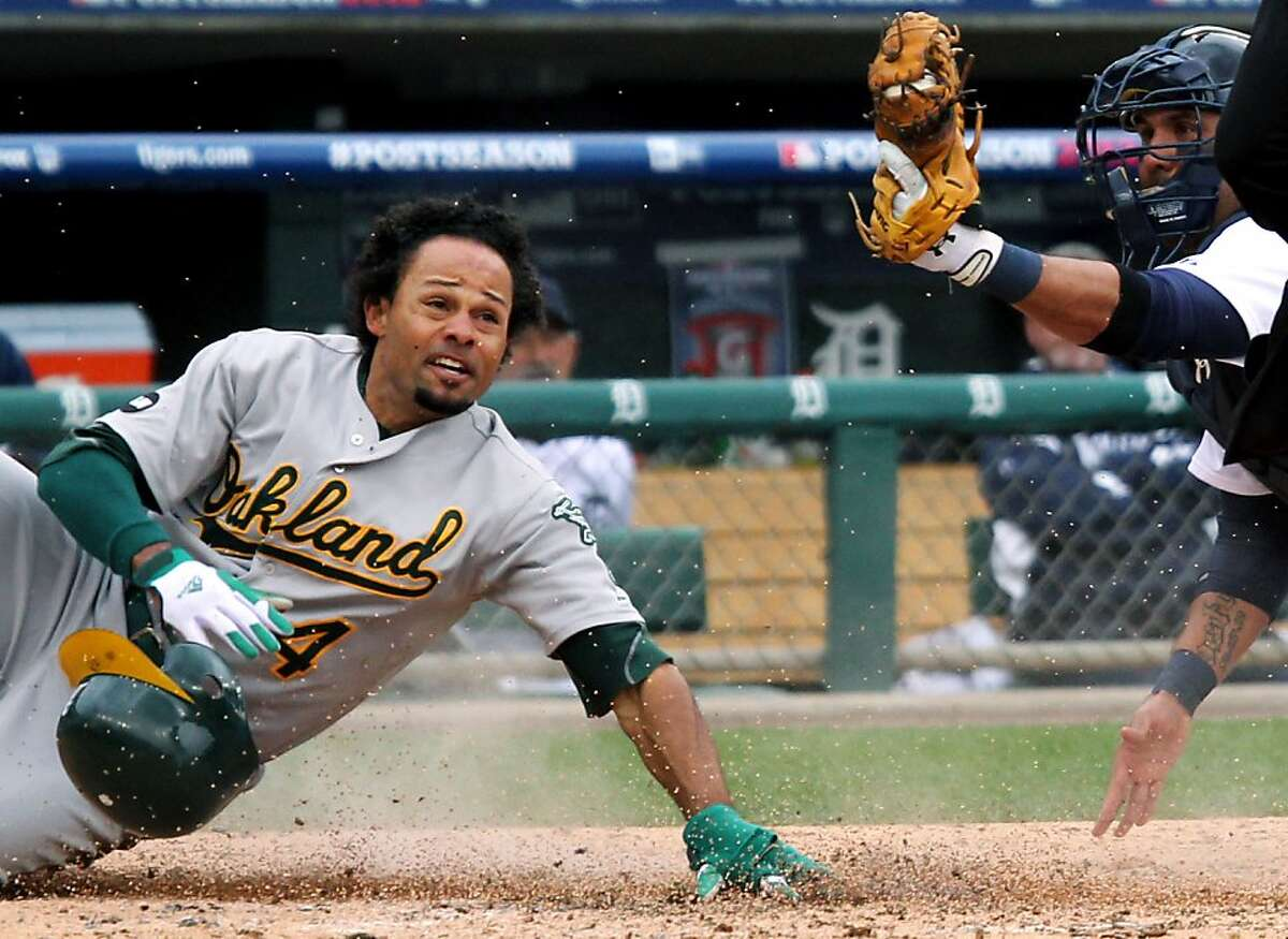 Oakland Athletics Coco Crisp is tagged out at home plate in the third inning by Detroit Tigers catcher Gerald Laird during Sunday October 7, 2012 in Detroit MI