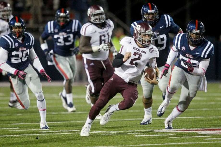 """2. Texas A&M (4-1, next week @ Louisiana Tech) — The next step in """"Johnny Football's"""" evolution happened as he led a gritty comeback on the road, despite struggling with turnovers against Ole Miss.(Rogelio V. Solis / Associated Press)"""