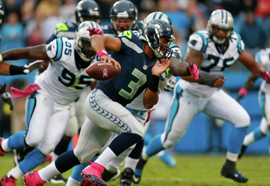 Seattle Seahawks' Russell Wilson (3) scrambles against the Carolina Panthers during the first quarter of an NFL football game in Charlotte, N.C., Sunday, Oct. 7, 2012. Photo: AP
