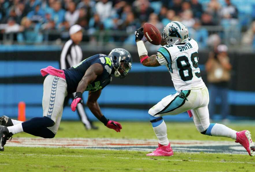 Carolina Panthers' Steve Smith (89) misses a catch as Seattle Seahawks' Kam Chancellor (31) defends