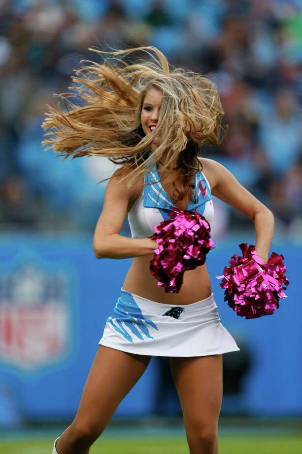 A Carolina Panthers cheerleader performs during the first quarter of an NFL football game against the Seattle Seahawks in Charlotte, N.C., Sunday, Oct. 7, 2012. Photo: AP