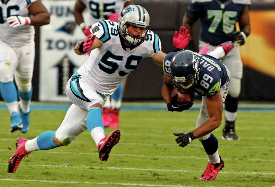 Seattle Seahawks' Doug Baldwin (89) is tackled by Carolina Panthers' Luke Kuechly (59) during the first quarter of an NFL football game in Charlotte, N.C., Sunday, Oct. 7, 2012. Photo: AP