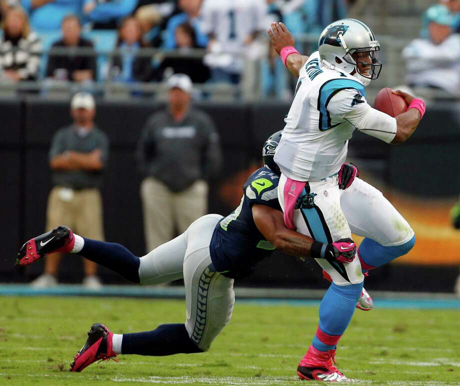 Carolina Panthers' Cam Newton (1) is tackled by Seattle Seahawks' Bobby Wagner (54) during the first quarter of an NFL football game in Charlotte, N.C., Sunday, Oct. 7, 2012. Photo: AP