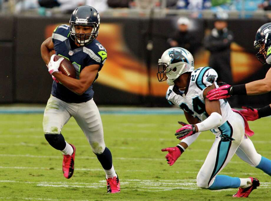 Seattle Seahawks' Golden Tate (81) runs past Carolina Panthers' Josh Norman (24) during the first quarter of an NFL football game in Charlotte, N.C., Sunday, Oct. 7, 2012. Photo: AP