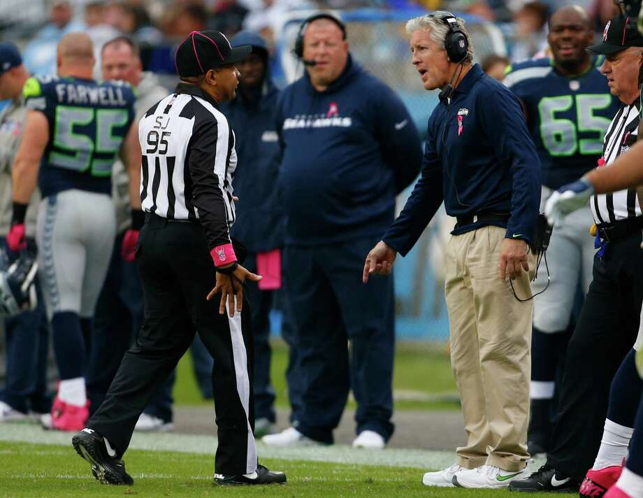 Seattle Seahawks head coach Pete Carroll, right, argues a call with side judge James Coleman (95) during the first quarter of an NFL football game in Charlotte, N.C., Sunday, Oct. 7, 2012. Photo: AP
