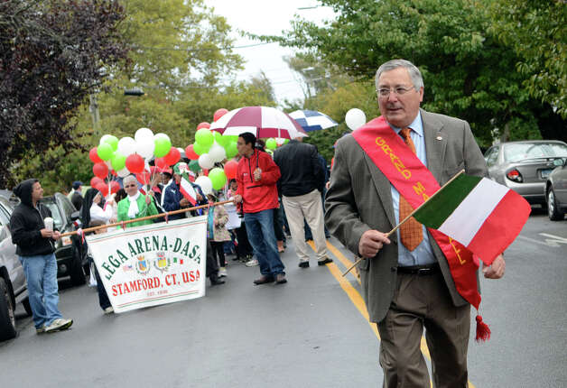 Grand marshal, former Stamford Mayor, Stanley Esposito leads the Columbus Day Parade on Sunday, Oct. 7 which kicked off at Sacred Heart Church on Schuyler Avenue in Stamford. Photo: Amy Mortensen / Connecticut Post Freelance