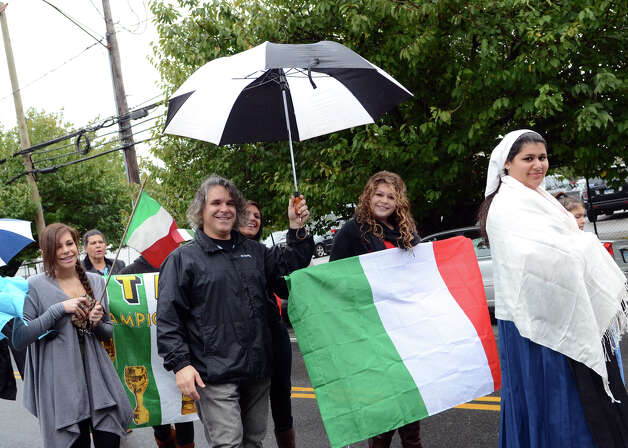 Participants walk in the Columbus Day Parade on Sunday, Oct. 7 which kicked off at Sacred Heart Church on Schuyler Avenue in Stamford. Photo: Amy Mortensen / Connecticut Post Freelance