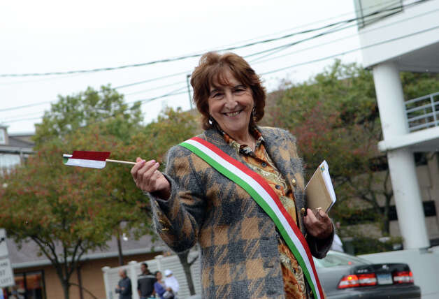 Tina Orgera, organizer of the I Giullari di Stamford Folklore Group, walks in the Columbus Day Parade on Sunday, Oct. 7 which kicked off at Sacred Heart Church on Schuyler Avenue in Stamford. Photo: Amy Mortensen / Connecticut Post Freelance