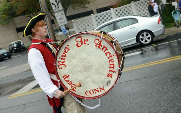 A member of the Deep River Junior Ancients Fife & Drum Corps marches in the Columbus Day Parade on Sunday, Oct. 7 which kicked off at Sacred Heart Church on Schuyler Avenue in Stamford. Photo: Amy Mortensen / Connecticut Post Freelance