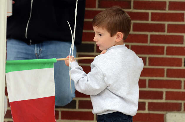 Raffaele Iorfino, 5, of Stamford, holds an Italian flag on the steps of Sacred Heart Church on Schuyler Avenue in Stamford during the Columbus Day Parade on Sunday, Oct. 7. Photo: Amy Mortensen / Connecticut Post Freelance