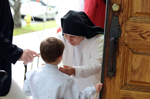 Sister Enrica Capalbo speaks with Raffaele Iorfino, 5, of Stamford, on the steps of Sacred Heart Church on Schuyler Avenue in Stamford during the Columbus Day Parade on Sunday, Oct. 7. Photo: Amy Mortensen / Connecticut Post Freelance
