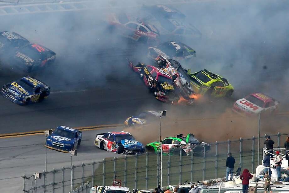 Tony Stewart (14) is in the middle of the mess he created - a 25-car crash on the final lap of the NASCAR Sprint Cup Series race at Talladega Superspeedway. Photo: Chris Graythen, Getty Images For NASCAR