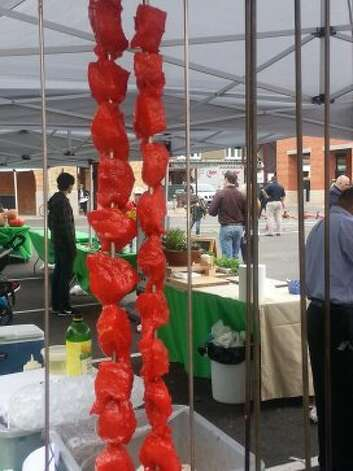 Chicken tikka from Mela Restaurant is skewered and ready to cook in the clay pit at Culinaria's Feastival.  (Jennifer McInnis / San Antonio Express-News)