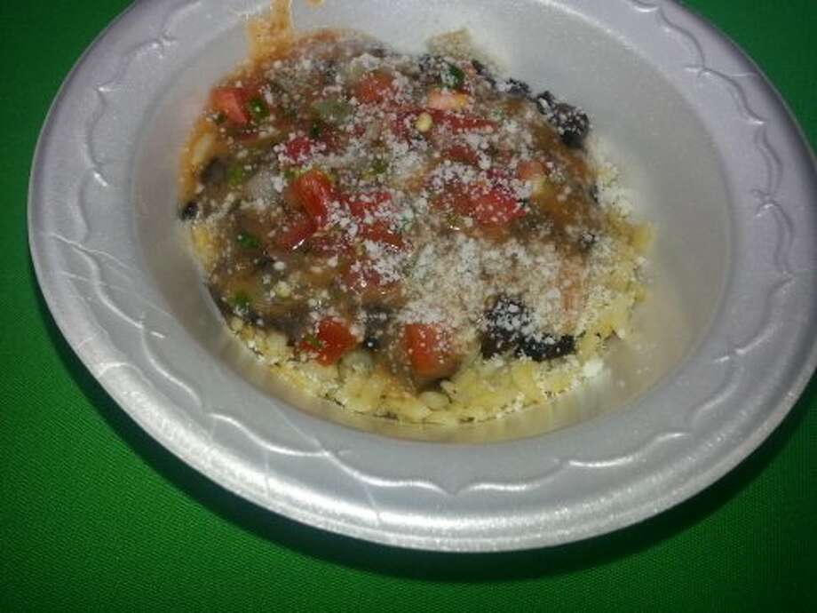 EZ's served Alamo Bowls to guests at Culinaria's Feastival event at Pearl. The recipe includes brown rice, black beans, pico de gallo and a tomato vinaigrette topped with cotija cheese.
