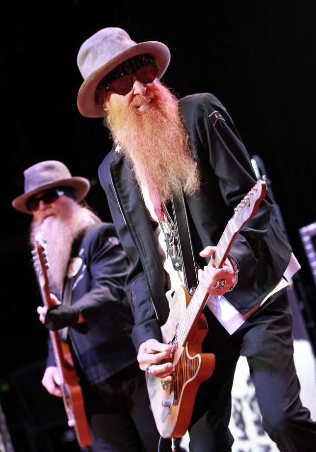 Dusty Hill (L) and Billy Gibbons of ZZ Top perform at the 2012 Virgin Mobile FreeFest on Saturday, October 6, 2012 in Columbia, Maryland. (Photo by Paul Morigi / Invision for Virgin Mobile/AP Images) Photo: Paul Morigi, Associated Press / Invision