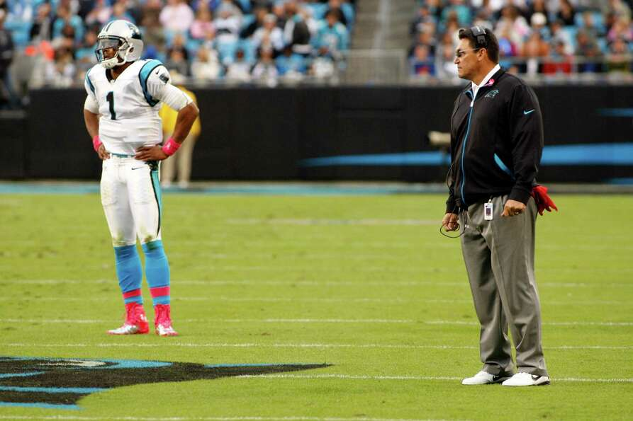 Carolina Panthers head coach Ron Rivera, right, and Cam Newton, left, look on during the second quar