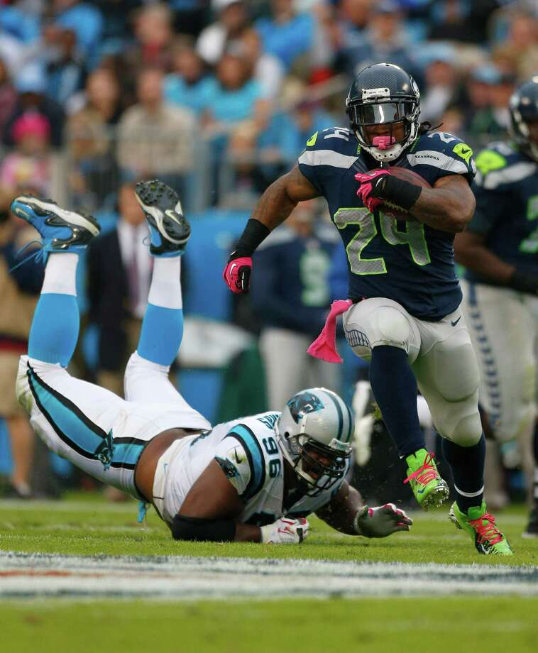 Seattle Seahawks' Marshawn Lynch (24) runs past Carolina Panthers' Ron Edwards (96) during the second quarter of an NFL football game in Charlotte, N.C., Sunday, Oct. 7, 2012. Photo: AP