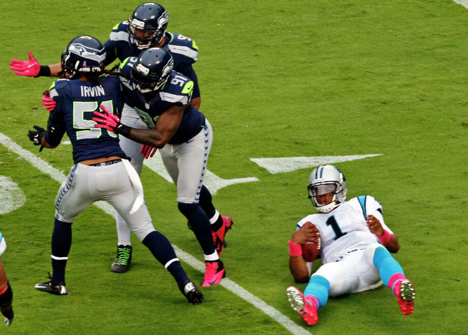 Seattle Seahawks' Bruce Irvin (51), Chris Clemons (91) and Jason Jones (90) celebrate a sack of Carolina Panthers' Cam Newton (1) during the second quarter of an NFL football game in Charlotte, N.C., Sunday, Oct. 7, 2012. Photo: AP