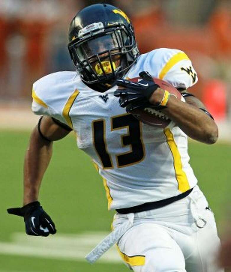 Andrew Buie, West Virginia, 31 carries, 207 yards, 2 TDs (Tom Reel / San Antonio Express-News)