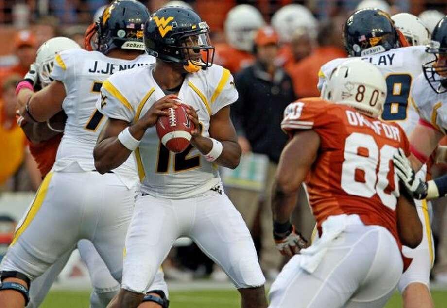 Geno Smith, West Virginia, 25-35-0, 268 yards, 4 TDs (Tom Reel / San Antonio Express-News)