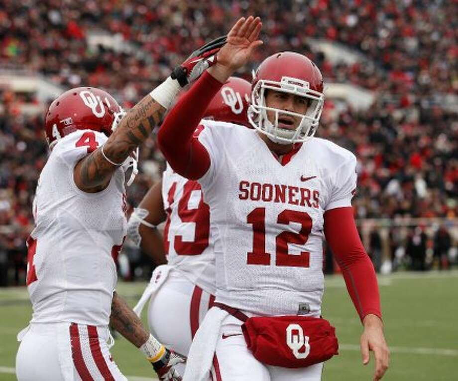 Landry Jones, Oklahoma, 25-40-0, 259 yards, 2 TDs  (Stephen Spillman / Associated Press)
