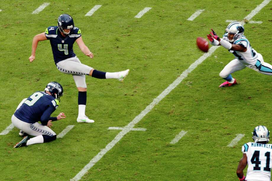 Seattle Seahawks' Steven Hauschka (4) kicks a field goal past the arms of Carolina Panthers' Josh Norman (24) during the second quarter of an NFL football game in Charlotte, N.C., Sunday, Oct. 7, 2012. Photo: AP