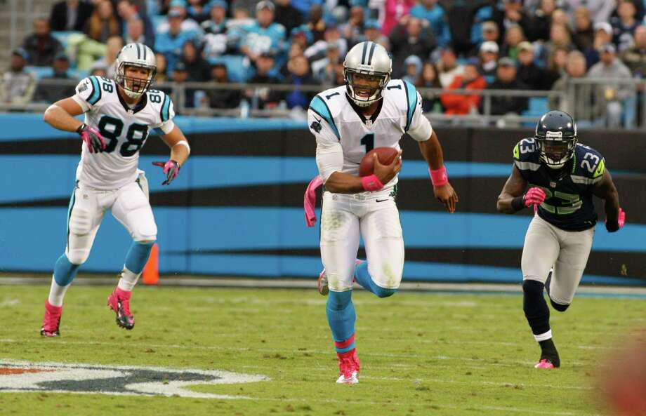 Carolina Panthers' Cam Newton (1) scrambles as Seattle Seahawks' Marcus Trufant (23) chases during the second quarter of an NFL football game in Charlotte, N.C., Sunday, Oct. 7, 2012. Photo: AP
