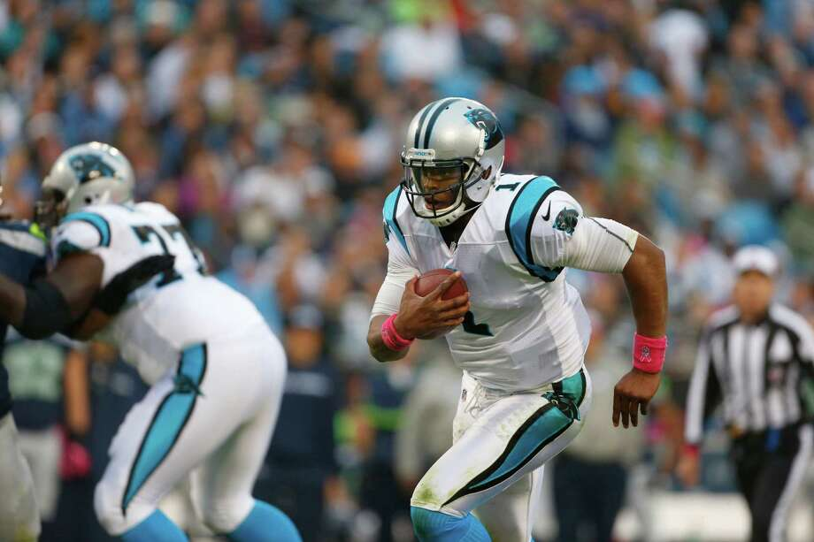 Carolina Panthers' Cam Newton (1) scrambles against the Seattle Seahawks during the second quarter of an NFL football game in Charlotte, N.C., Sunday, Oct. 7, 2012. Photo: AP