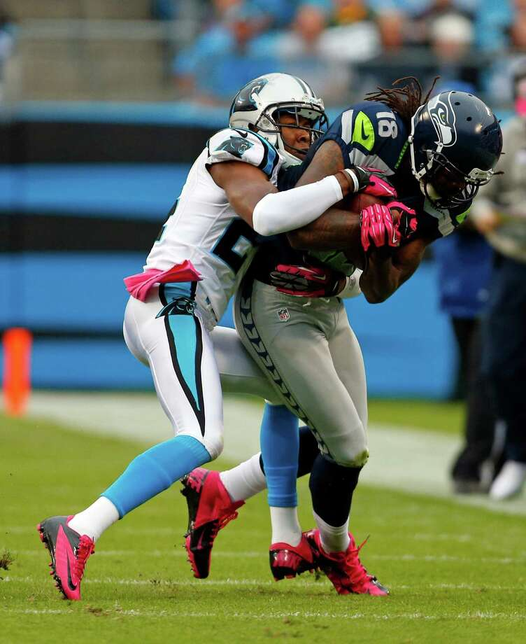 Seattle Seahawks' Sidney Rice (18) is tackled by Carolina Panthers' Josh Norman (24) during the second quarter of an NFL football game in Charlotte, N.C., Sunday, Oct. 7, 2012. Photo: AP
