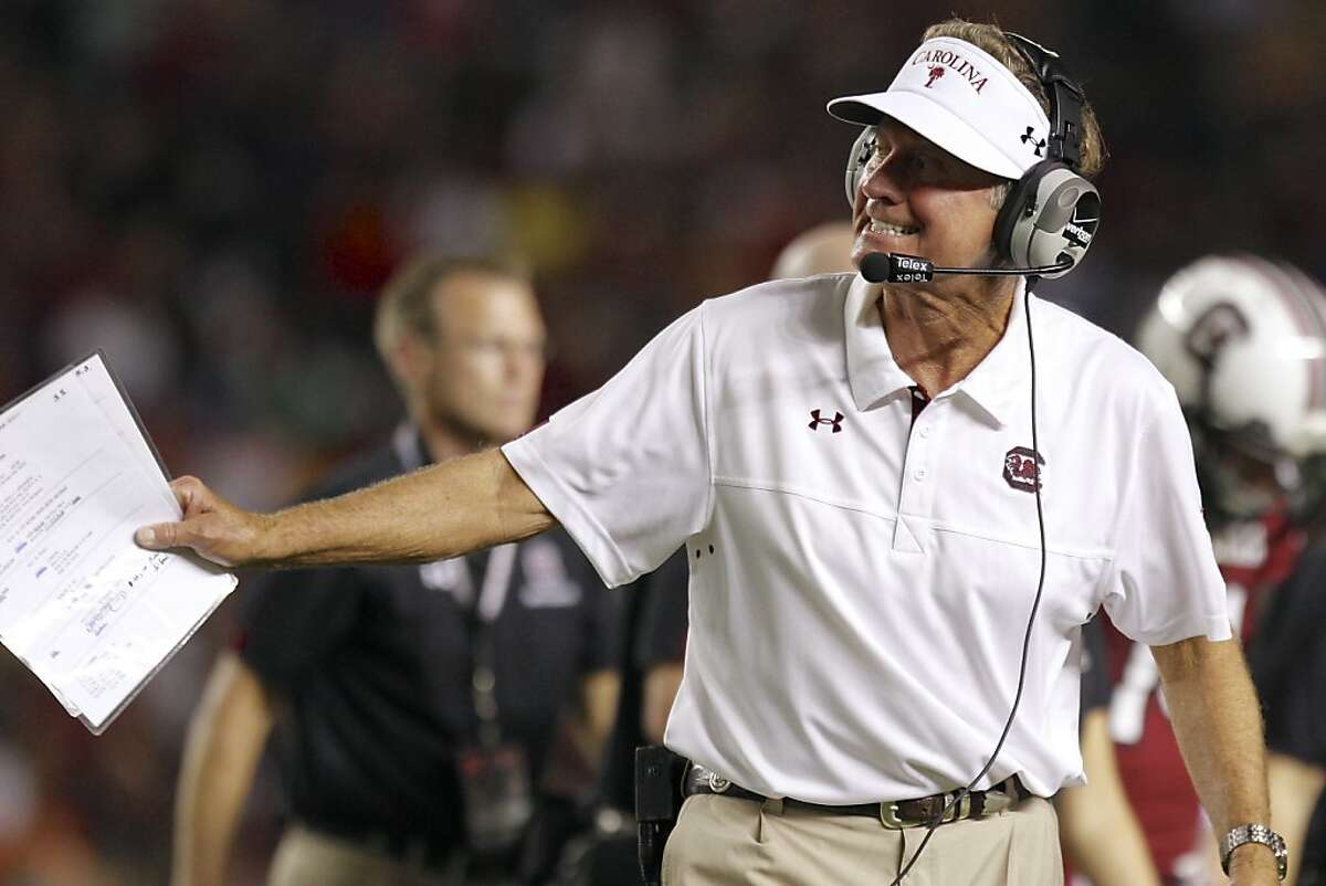 South Carolina head coach Steve Spurrier calls in a play to quarterback Dylan Thompson during the first half of an NCAA college football game against UAB at Williams-Brice Stadium in Columbia, S.C., Saturday, Sept. 15, 2012. (AP Photo/Brett Flashnick)