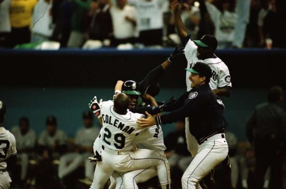 This image was taken just after The Double – Edgar Martinez's hit that put the Mariners over the Yankees in Game 5 of the 1995 AL Division Series – and was not published until being pulled from the seattlepi.com archive in Oct. 2012. The negatives are preserved at the Museum of History and Industry, which is a longtime partner of the P-I. This previously unpublished image, which has not been cropped from the full frame, was taken Oct. 8, 1995. (Robin Layton/seattlepi.com/MOHAI)