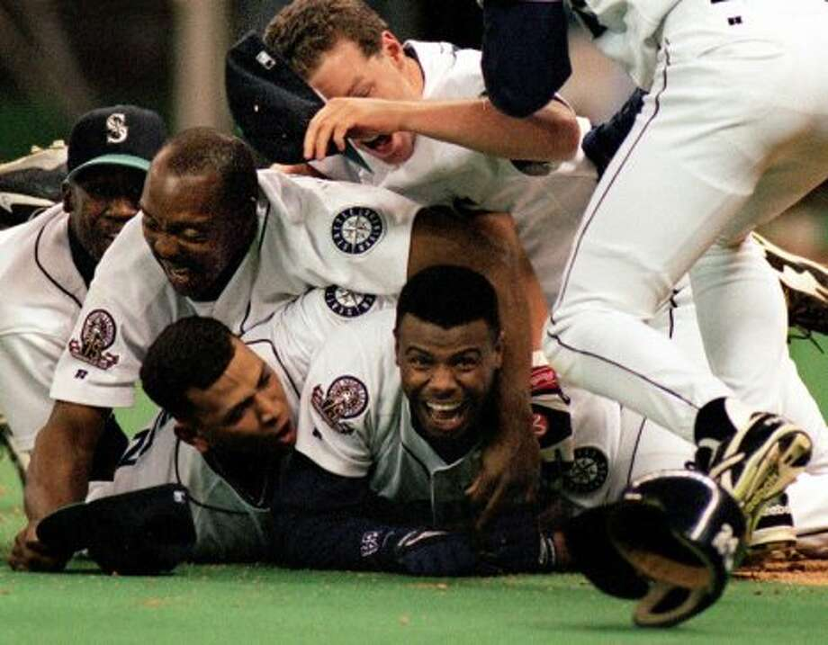 "The cropped image appeared on the front of the Oct. 9, 1995 P-I under the banner headline ""M's do it!"" That newspaper sold out, and commemorative T-shirts were made with that front page. (Robin Layton/seattlepi.com/MOHAI)"