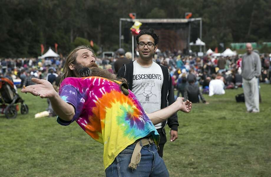 Loopy Enchilada (left) plays hacky sack with Carlos Cuadra in front of the Arrow Stage while attending the last day of Hardly Strictly Bluegrass in Golden Gate Park in San Francisco, Calf., on Sunday, October 7, 2012. Photo: Laura Morton, Special To The Chronicle