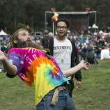 Loopy Enchilada (left) plays hacky sack with Carlos Cuadra in front of the Arrow Stage while attending the last day of Hardly Strictly Bluegrass in Golden Gate Park in San Francisco, Calf., on Sunday, October 7, 2012.