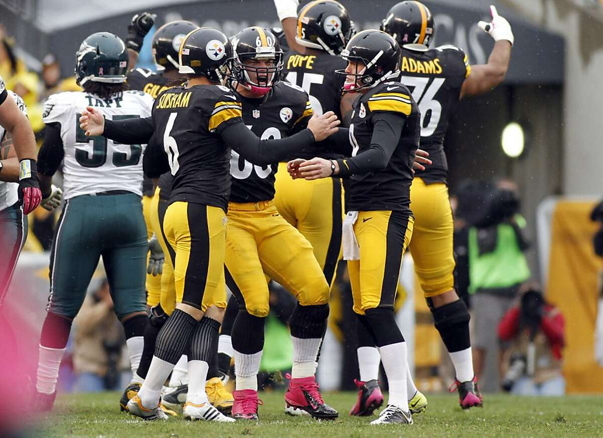 PITTSBURGH, PA - OCTOBER 07: Place kicker Shaun Suisham #6 of the Pittsburgh Steelers celebrates with Greg Warren #60 and Drew Butler #9 of the Pittsburgh Steelers after kicking the game winning field goal in the fourth quarter against the Philadelphia Eagles during the game on October 7, 2012 at Heinz Field in Pittsburgh, Pennsylvania. The Steelers defeated the Eagles 16-14. (Photo by Justin K. Aller/Getty Images)