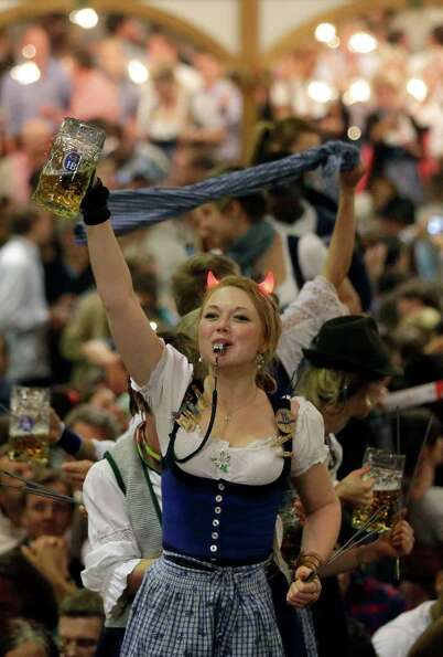 A waitress dances on tables in a beer tent on the final evening of the famous Bavarian