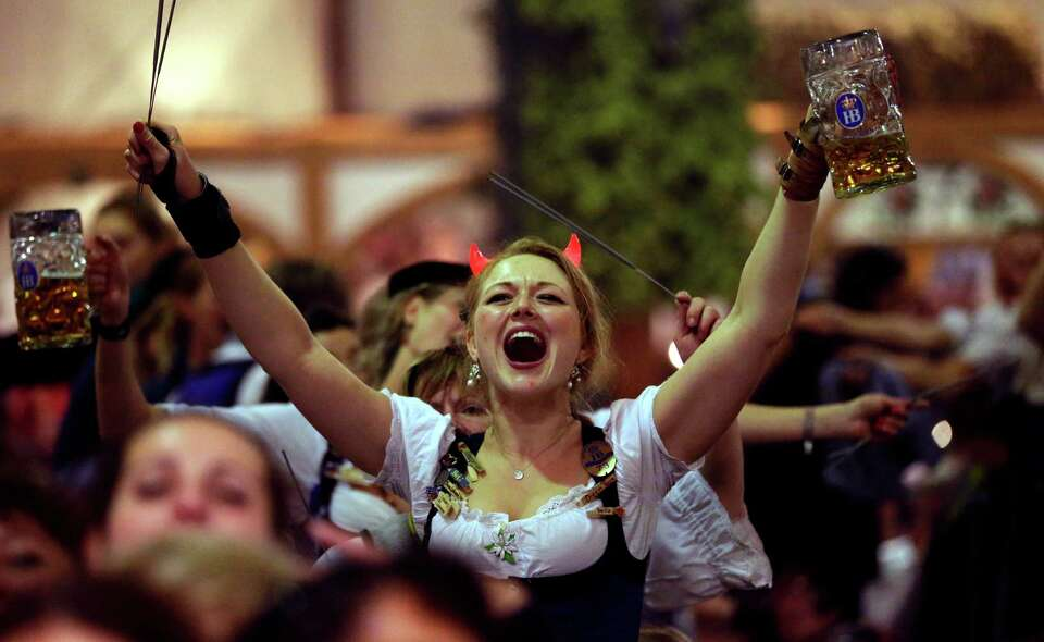 Waitresses dance on tables in a beer tent on the final evening of the famous Bavarian