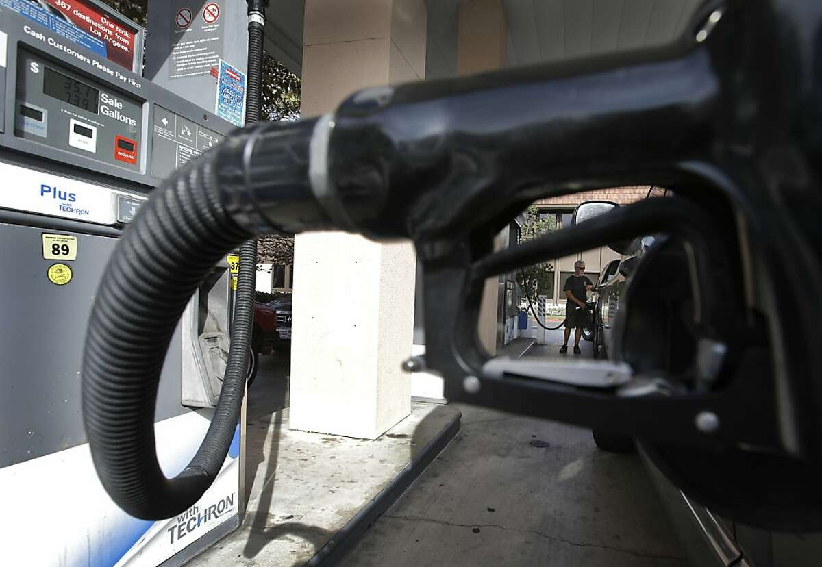 A customer fills his tank at a Chevon service station in Tustin, Calif. Saturday, Oct. 6, 2012. In many areas in California, gas prices have jumped 40 cents in a week as refinery problems have created shortages and helped send wholesale prices soaring. (AP Photo/Chris Carlson)