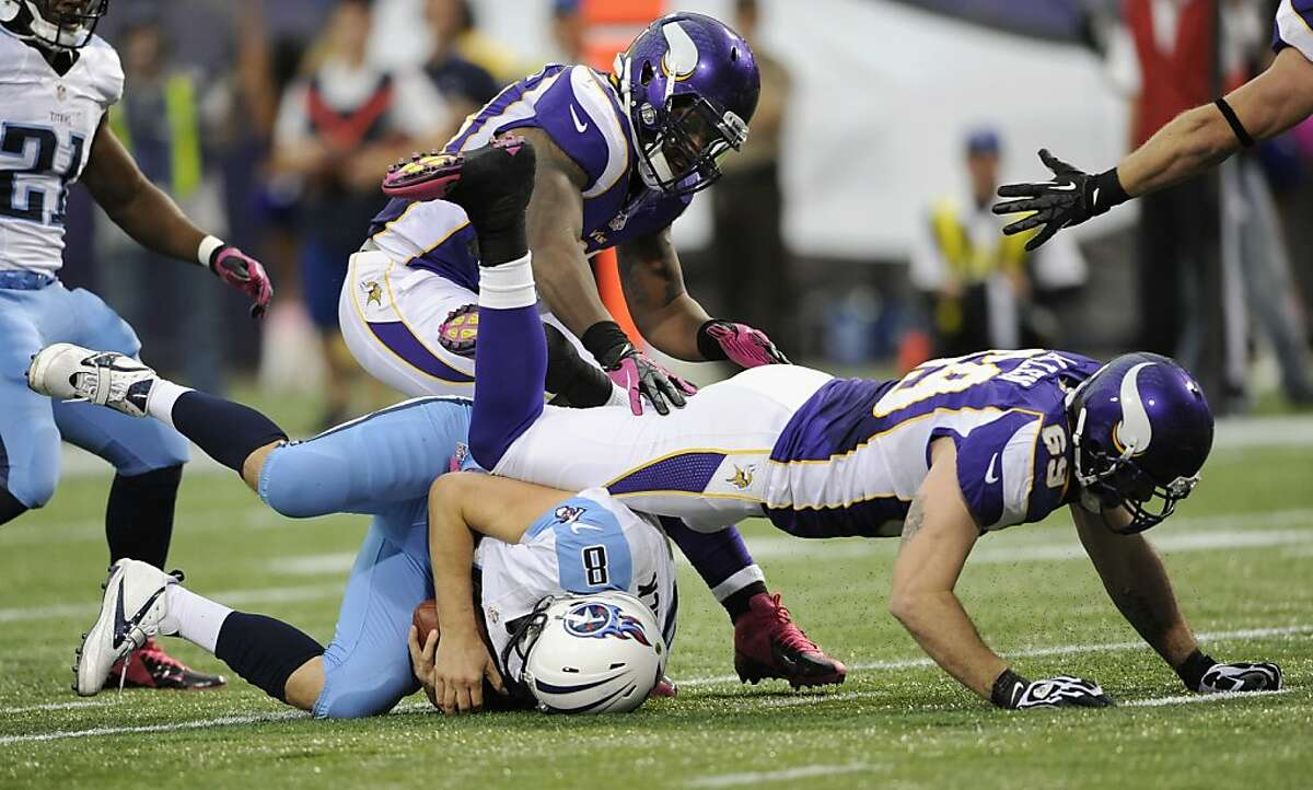 MINNEAPOLIS, MN - OCTOBER 7: Matt Hasselbeck #8 of the Tennessee Titans is sacked by Jared Allen #69 of the Minnesota Vikings during the second quarter of the game on October 7, 2012 at Mall of America Field at the Hubert H. Humphrey Metrodome in Minneapolis, Minnesota. (Photo by Hannah Foslien/Getty Images)