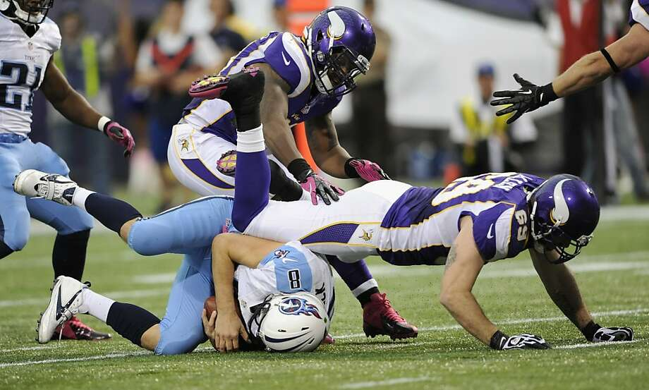 Matt Hasselbeck (on ground) is sacked by Jared Allen of the Vikings, who are tied with Chicago for first place in the NFC North. Photo: Hannah Foslien, Getty Images
