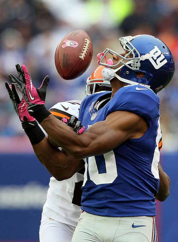 EAST RUTHERFORD, NJ - OCTOBER 07: Wide receiver Victor Cruz #80 of the New York Giants makes a catch against the Cleveland Browns during their game at MetLife Stadium on October 7, 2012 in East Rutherford, New Jersey.  (Photo by Alex Trautwig/Getty Images) *** BESTPIX *** Photo: Alex Trautwig, Getty Images
