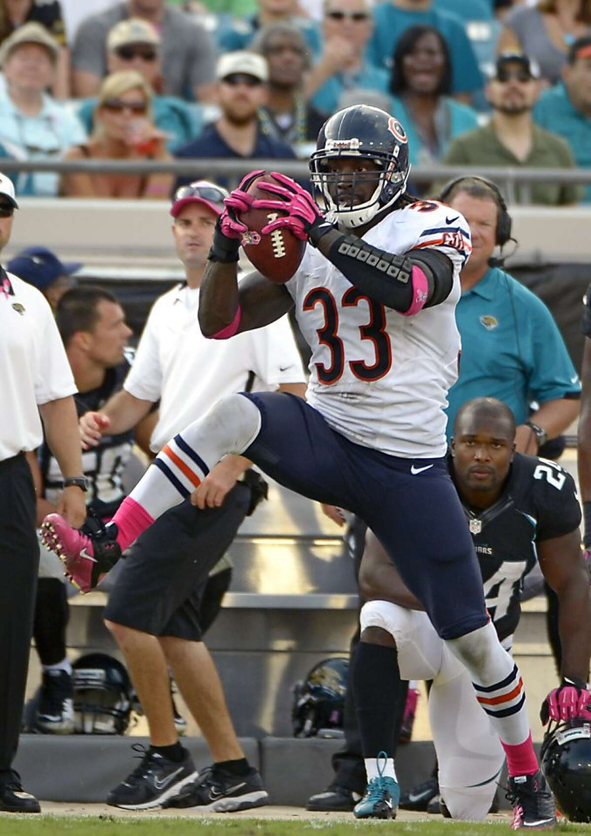 Chicago Bears cornerback Charles Tillman (33) intercepts a Jacksonville Jaguars pass before running it back for a 36-yard touchdown during the second half of an NFL football game, Sunday, Oct. 7, 2012, in Jacksonville, Fla. (AP Photo/Phelan M. Ebenhack)