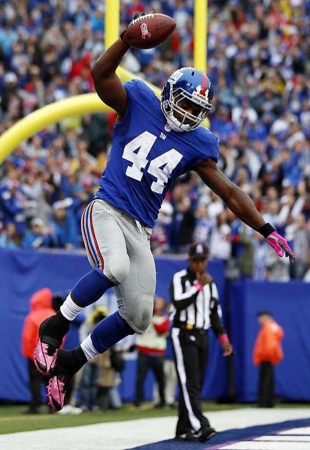 Giants running back Ahmad Bradshaw started his day with a fumble that led to the Browns' first touchdown, but 200 rushing yards later, he celebrated a win. Photo: Julio Cortez, Associated Press