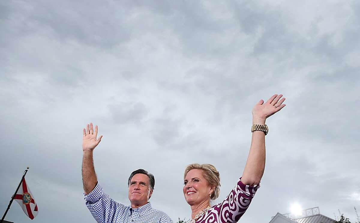 PORT ST. LUCIE, FL - OCTOBER 07: Republican presidential candidate, former Massachusetts Gov. Mitt Romney (L) and his wife Ann Romney wave to supporters during a victory rally at Tradition Town Square on October 7, 2012 in Port St. Lucie, Florida. Mitt Romney is campaigning in Florida before traveling to Virginia where he is scheduled to give a foreign policy speech at the Virginia Military Institute. (Photo by Justin Sullivan/Getty Images)