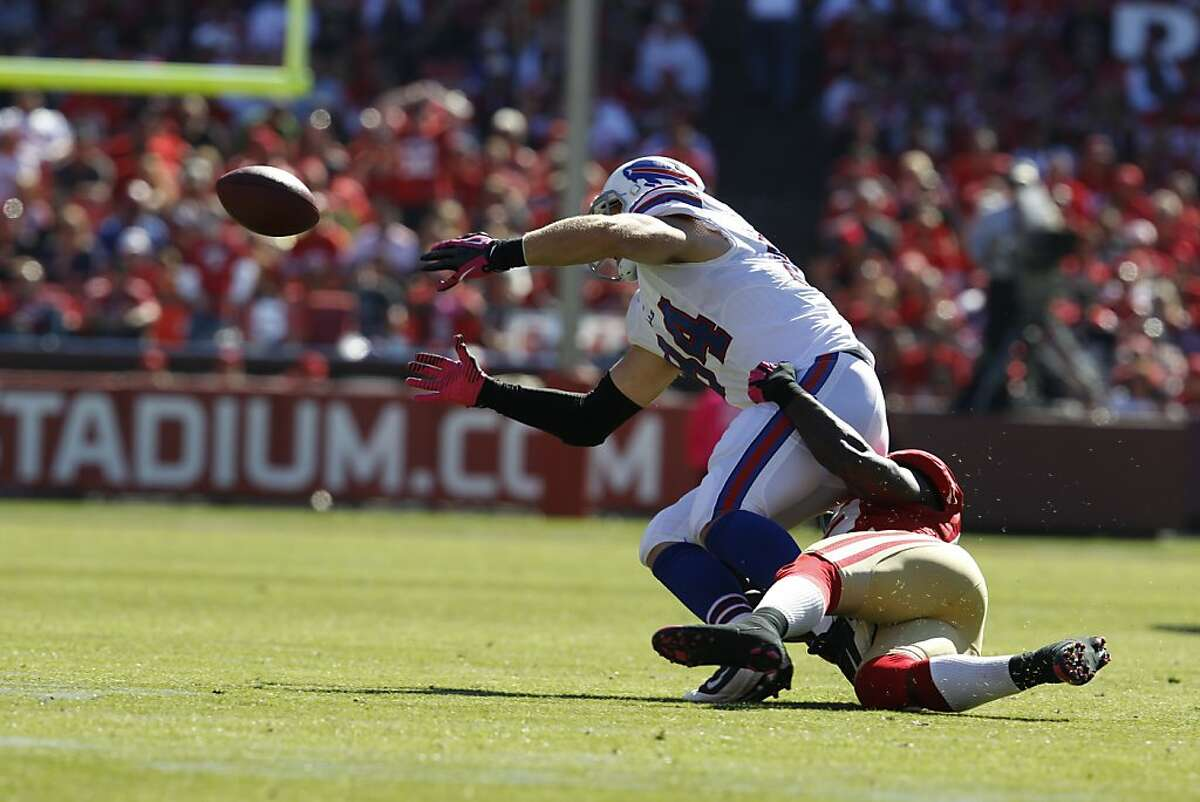 49ers Patrick Willis causes Buffalo Bills Scott Chandler to fumble in the second quarter. The San Francisco 49ers played the Buffalo Bills at Candlestick Park in San Francisco, Calif., on Sunday October 7, 2012.