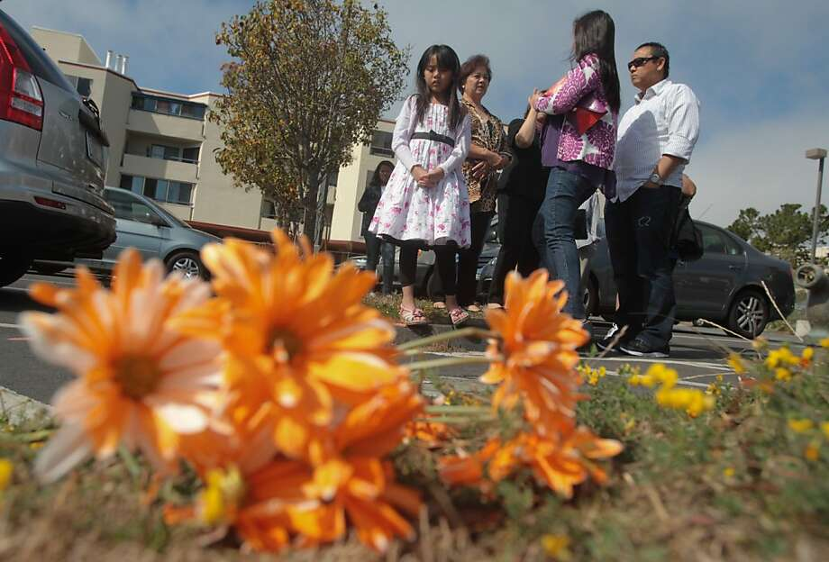 Erynn Donaire, 8, stands with her family near the spot where a car accident killed 6-year-old Danielle Naval on Saturday in the parking lot at St. Andrew Catholic Church in Daly City. Photo: Mathew Sumner, Special To The Chronicle