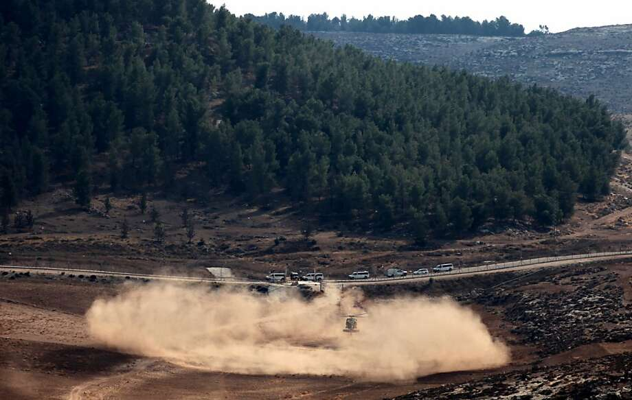 An Israeli army helicopter lands as soldiers search for the remains of a drone in southern Israel. The unmanned aircraft flew deep into Israeli airspace before warplanes shot it down. Photo: Yehuda Lachiani, Associated Press