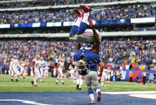 EAST RUTHERFORD, NJ - OCTOBER 07:  David Wilson #22 of the New York Giants celebrates his touchdown against the Cleveland Browns by doing a backflip during their game at MetLife Stadium on October 7, 2012 in East Rutherford, New Jersey.  (Photo by Al Bello/Getty Images) *** BESTPIX *** Photo: Al Bello, Getty Images / 2012 Getty Images