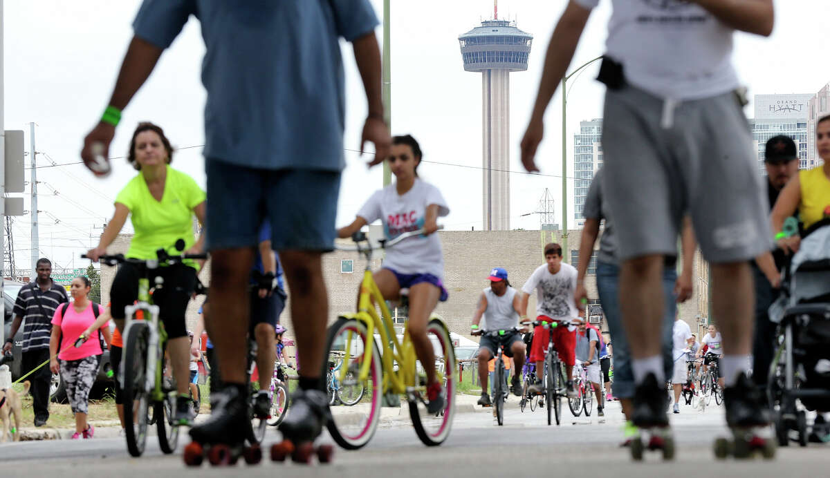 The Tower of the Americas is framed by people taking part in Siclovia Sunday Sep. 29, 2013.