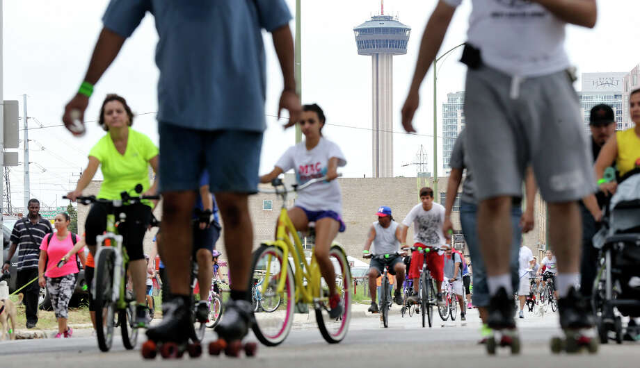 The Tower of the Americas is framed by people taking part in Siclovia Sunday Sep. 29, 2013. Photo: Edward A. Ornelas, San Antonio Express-News / © 2013San Antonio Express-News